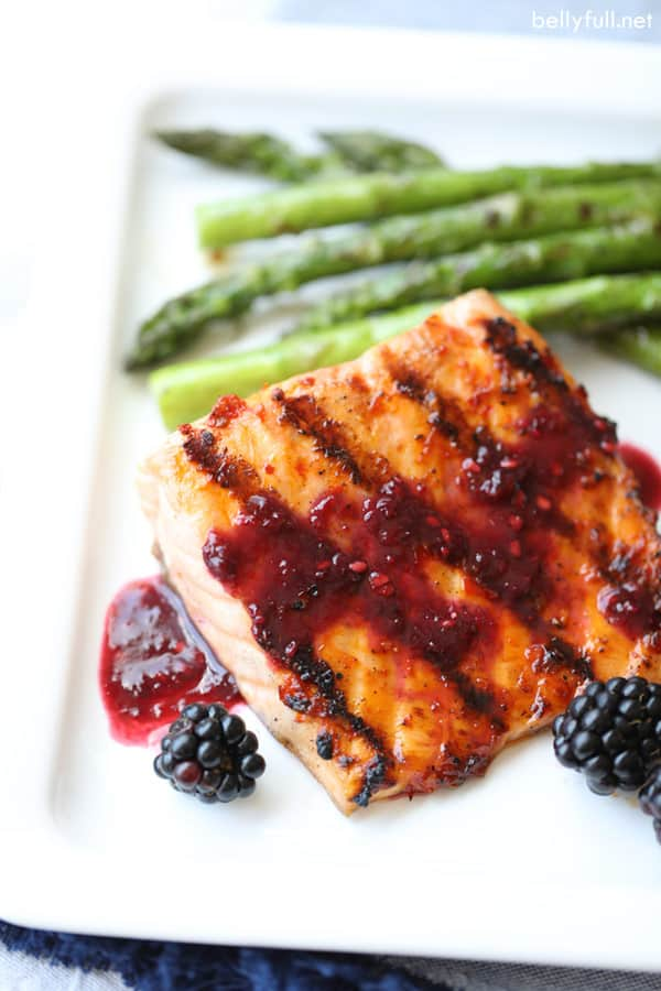 Grilled Salmon with Blackberry Sauce on white plate