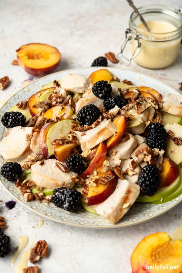 Honey Chicken Salad with blackberries and peaches on ornate plate
