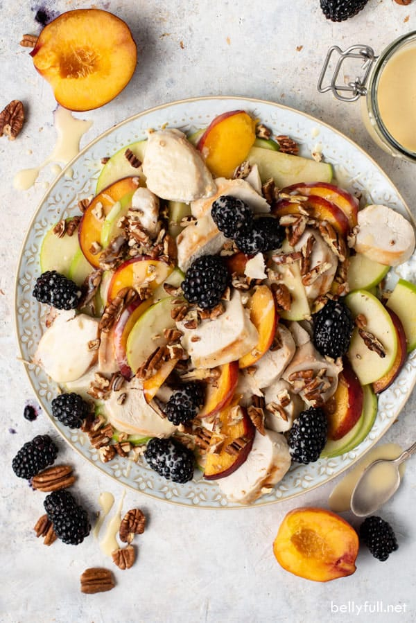 overhead of Grilled Chicken Salad with peaches and blackberries