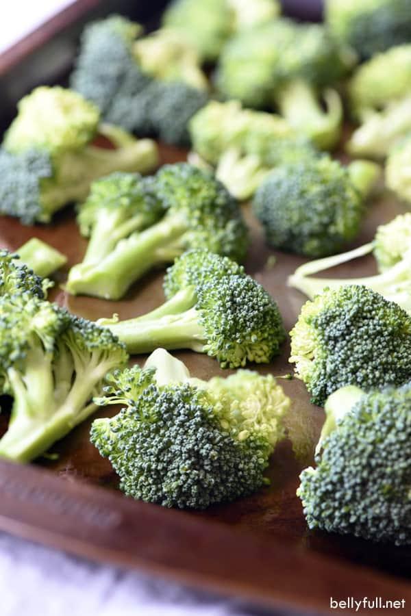 broccoli florets on roasting pan