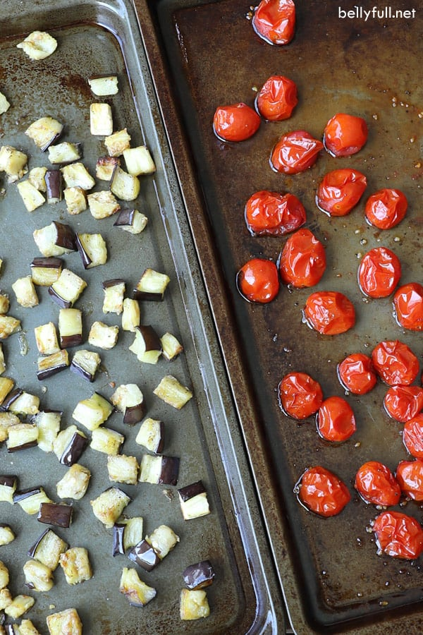 Spicy Roasted Eggplant and Cherry Tomatoes on baking sheets