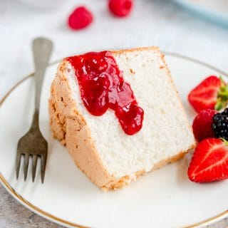 slice of angel food cake with strawberry sauce