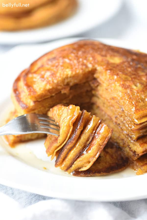 bite of pumpkin pancakes on fork