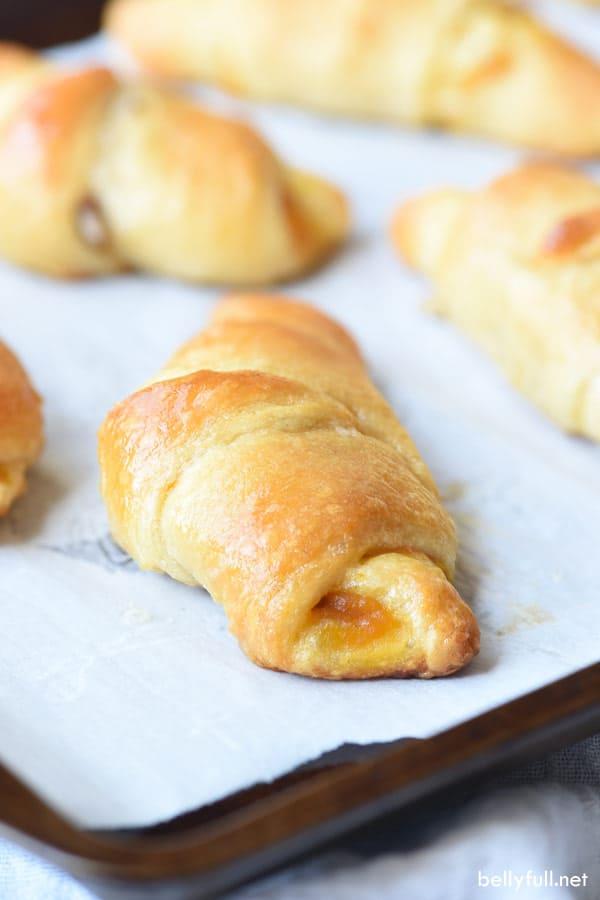 baked Pumpkin Pecan Crescent Rolls on baking sheet