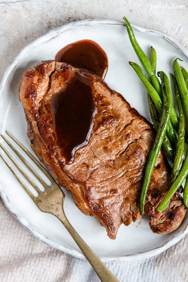 pan seared steak on white plate with sauce