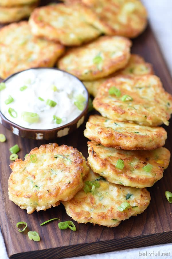 Zucchini Corn Fritters piled on cutting board