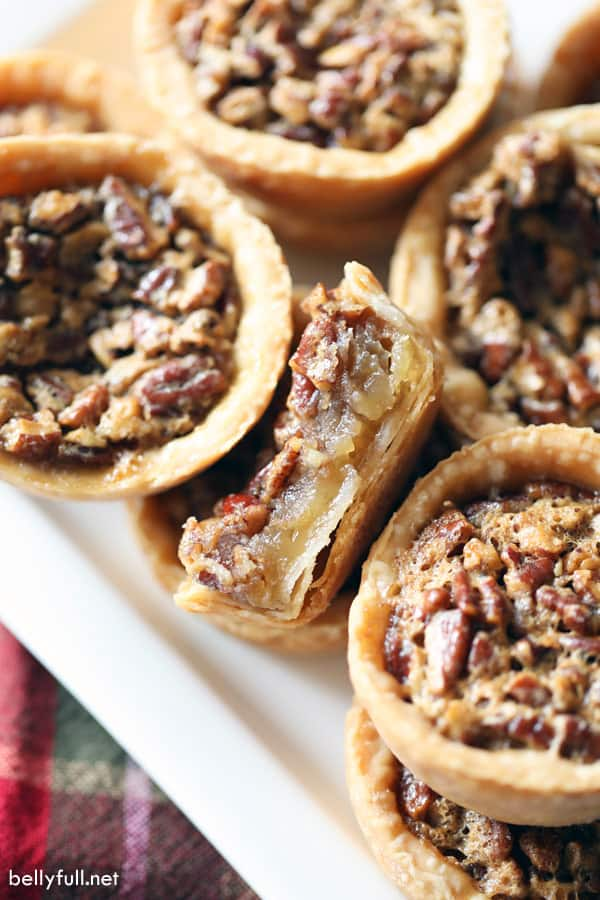 mini pecan pie cut in half with gooey filling