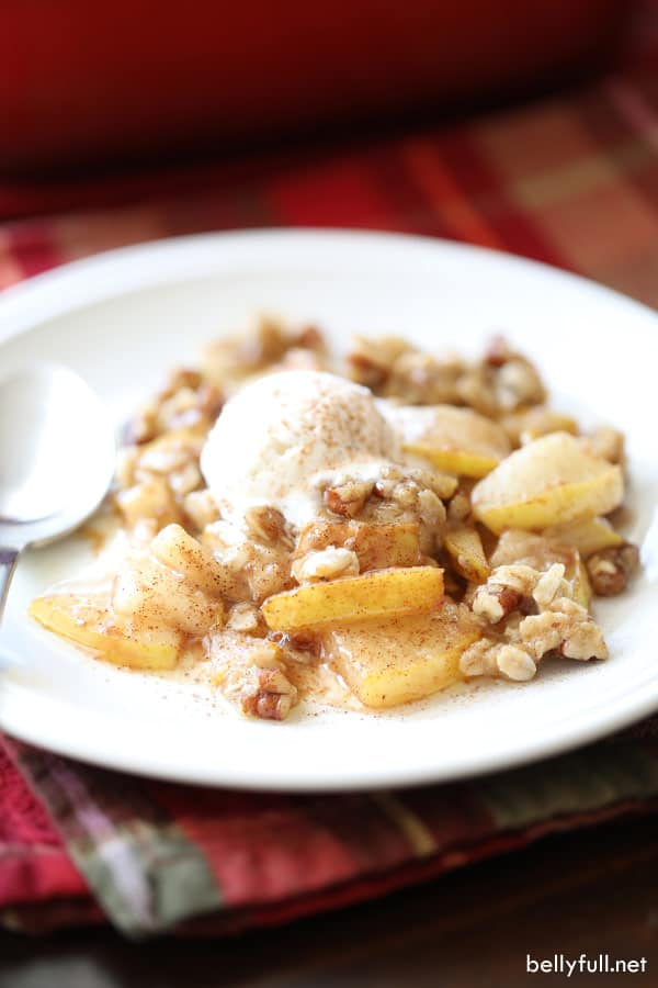 pears, pecans, and vanilla ice cream on white plate