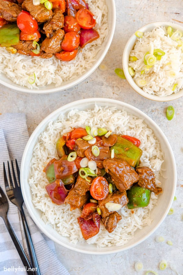 overhead image of beef stir fry on white rice