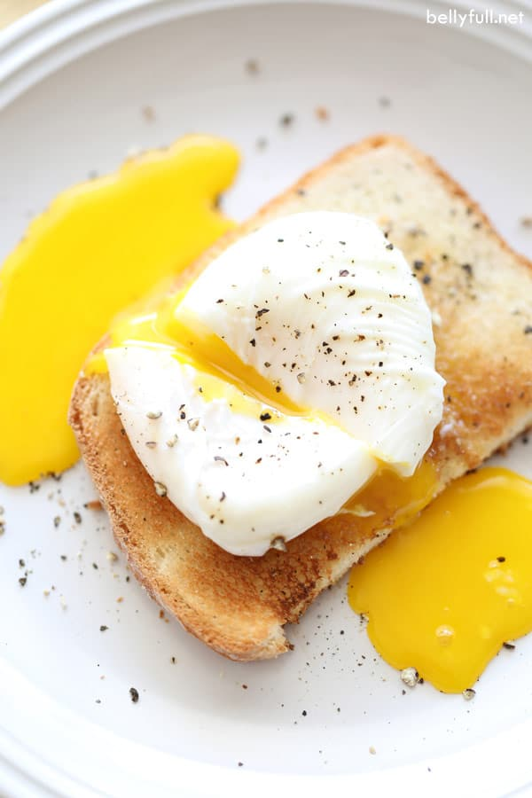 poached egg split in half with runny yolk