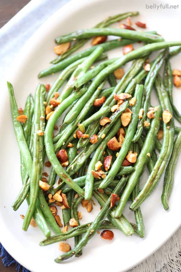 roasted green beans on white serving platter
