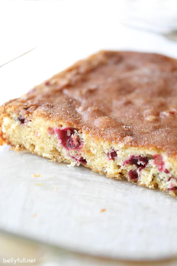 cranberry coffee cake in glass baking pan