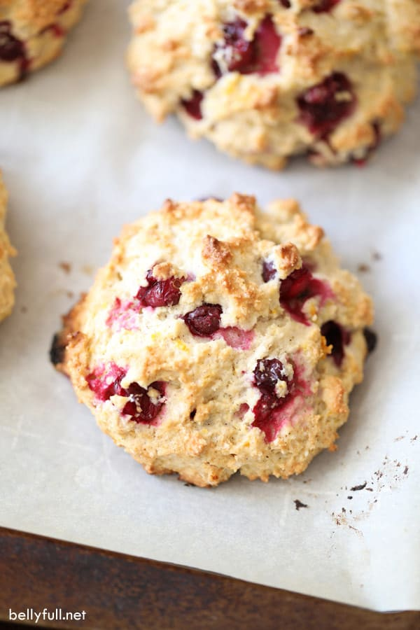 cranberry drop biscuits with orange zest on baking sheet