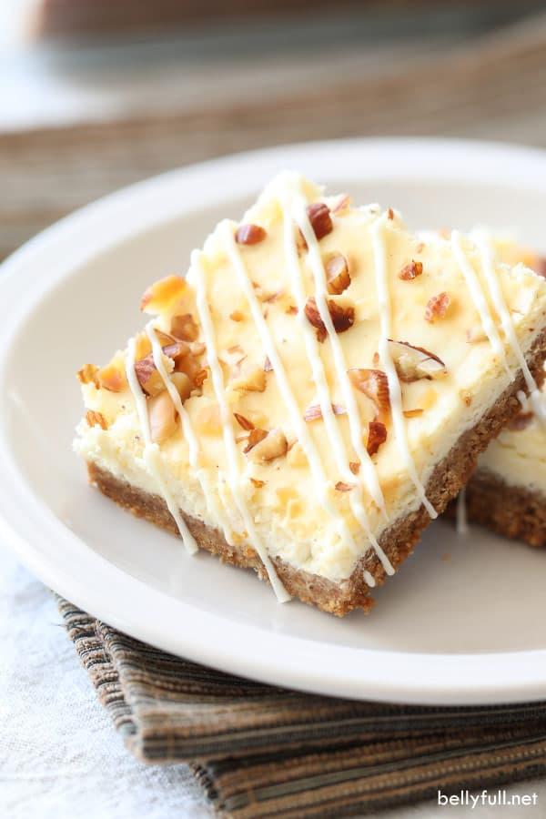 two eggnog cheesecake bars on white plate