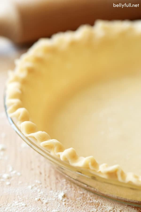 uncooked pie crust in pie plate with fluted edge