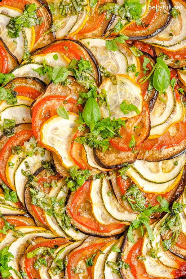 beautiful roasted vegetables in a spiral pattern with fresh chopped herbs