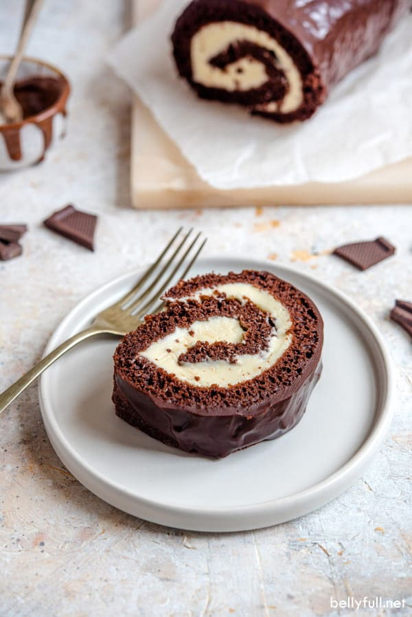 slice of swiss roll cake on white plate