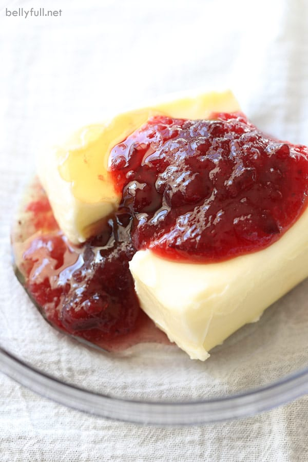 butter, cranberry sauce, and honey in glass mixing bowl