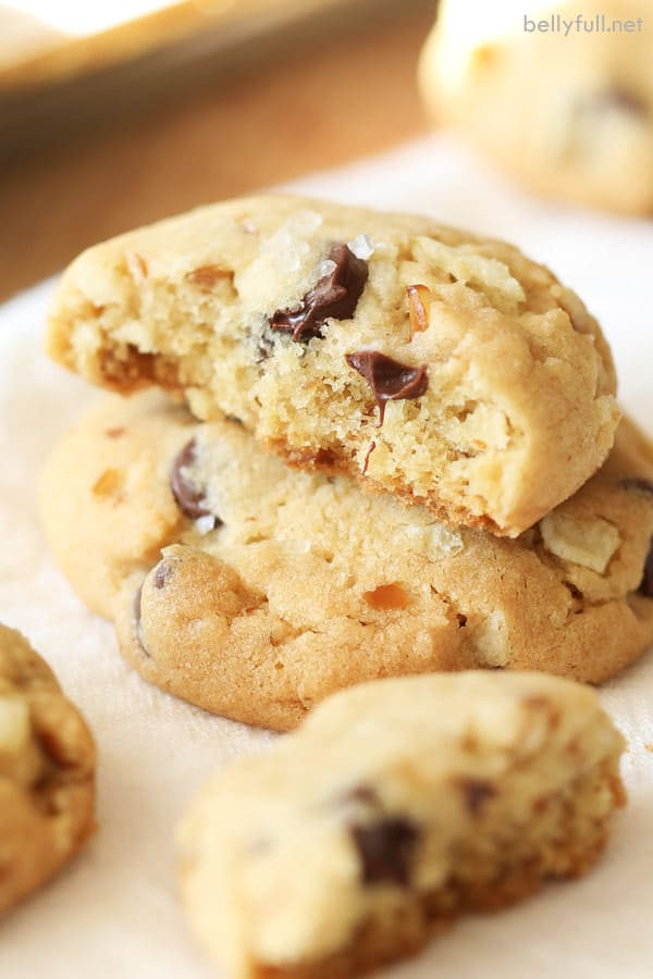 Kitchen Sink Cookies cut in half with gooey melted chocolate chips