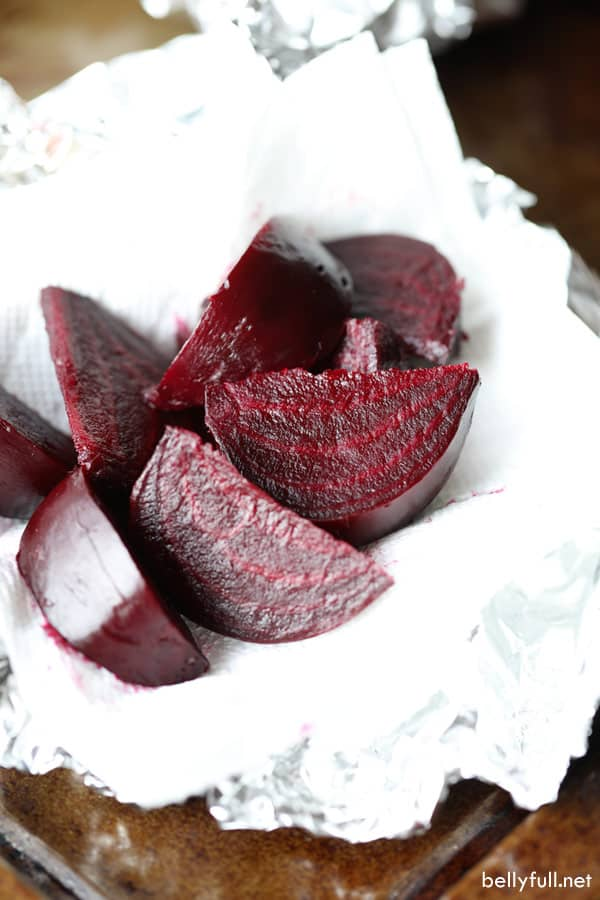roasted beets cut into wedges on paper towel