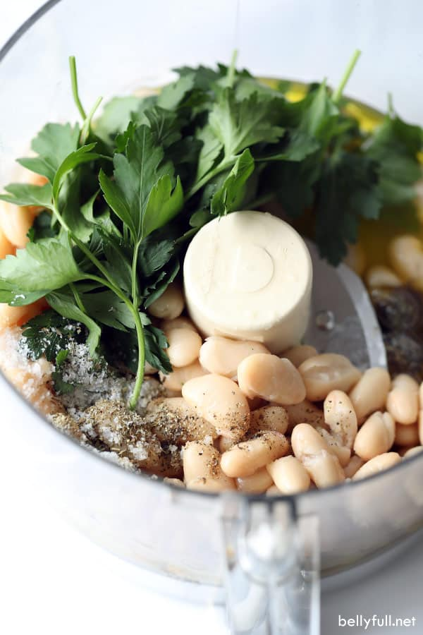 ingredients for white bean dip in food processor bowl