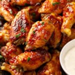 glazed baked chicken wings stacked on plate