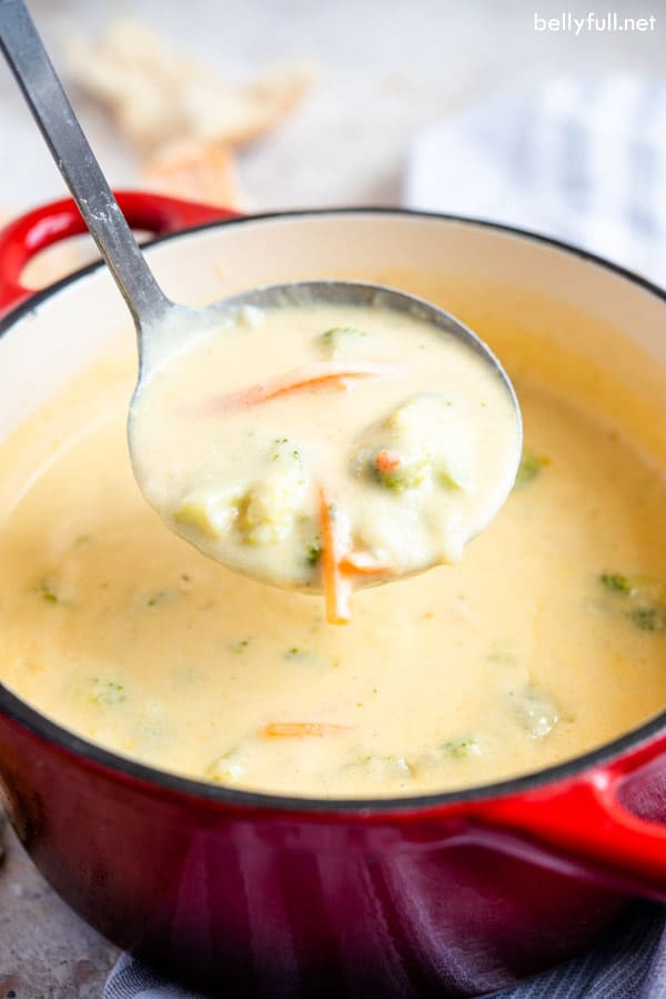 Broccoli Cheddar Soup in ladle over pot