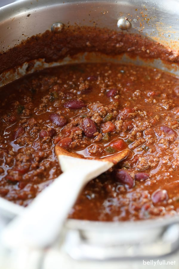 easy chili in soup pot with wooden spoon