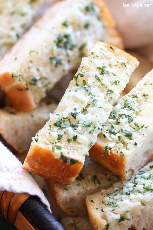 sliced garlic bread in bread basket