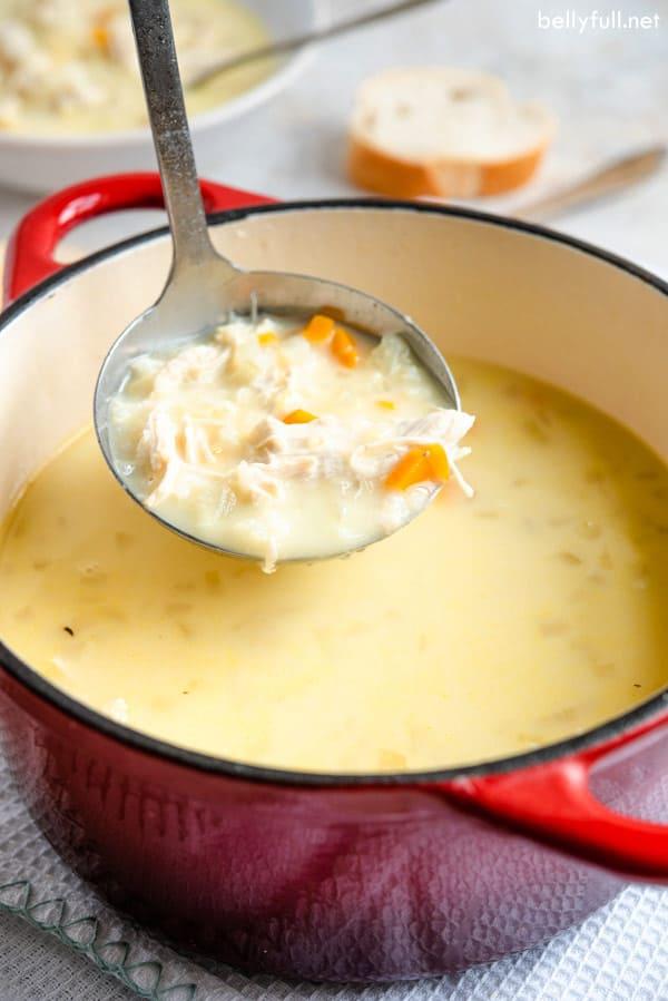 scoop full of Avgolemono Soup on ladle