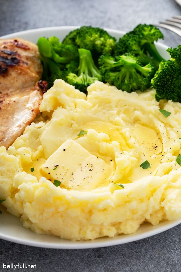 mashed potatoes on white plate with broccoli and grilled chicken