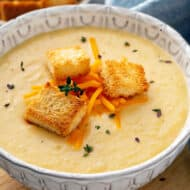 Creamy Cauliflower Soup in bowl with croutons