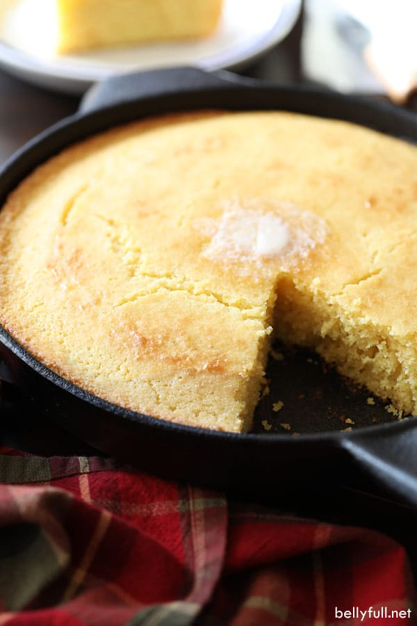 cornbread in cast iron skillet with slice missing