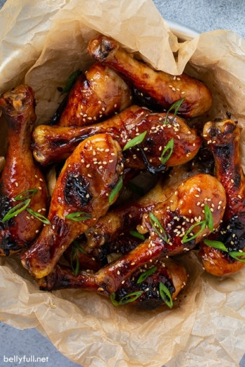 overhead picture of honey soy chicken drumsticks in bowl