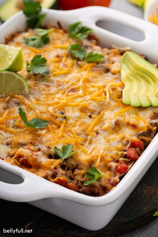 Mexican Lasagna in white casserole dish