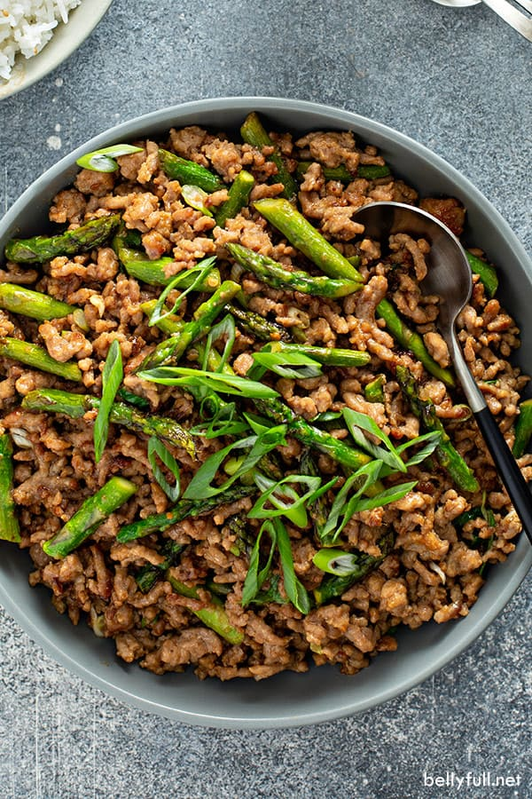overhead picture of ground pork stir fry with asparagus in serving bowl