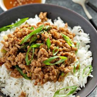 ground pork stir fry over white rice in bowl