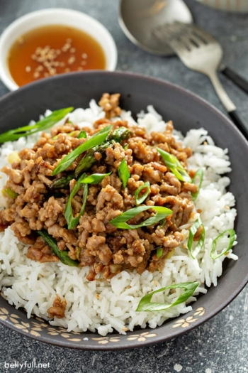 ground pork stir fry over white rice in bowl