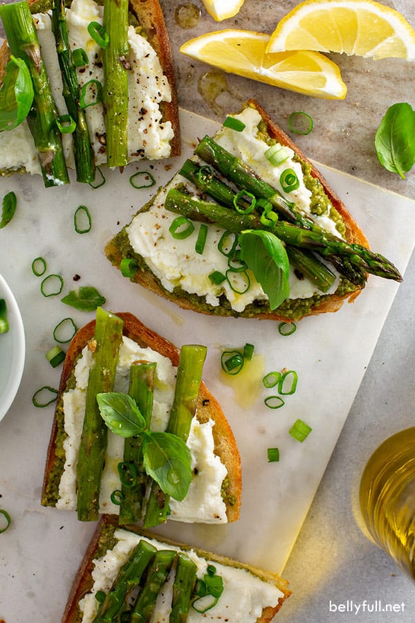 overhead picture of roasted asparagus and ricotta crostini