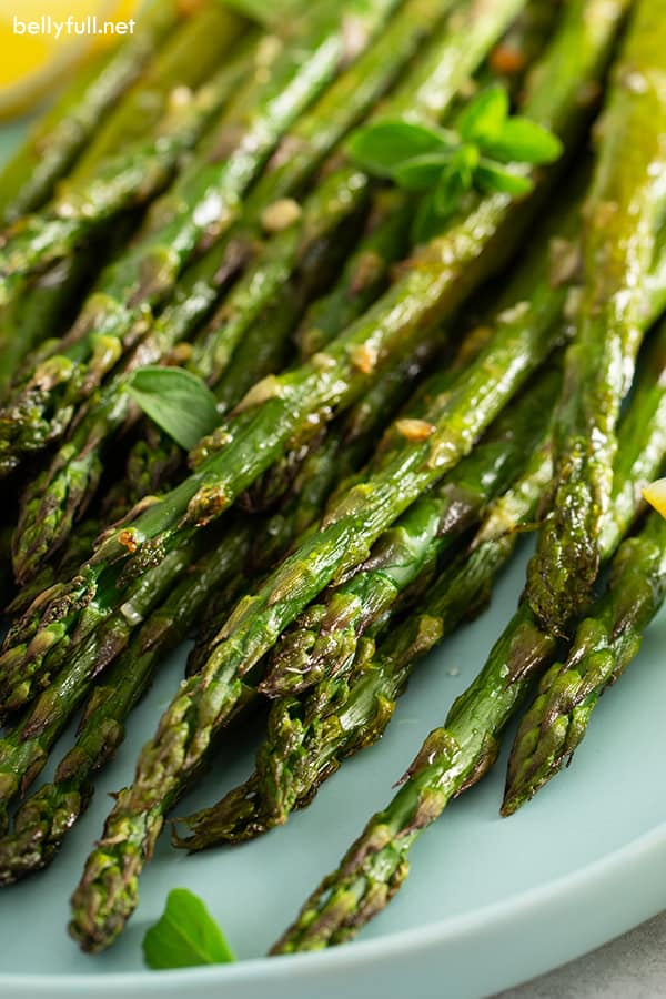 close up picture of roasted asparagus on serving plate