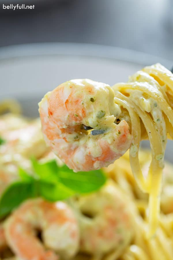 shrimp and creamy pesto pasta swirled around fork