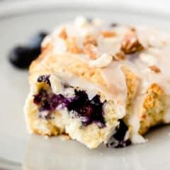 blueberry scone on plate, split on half