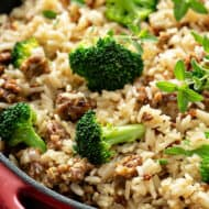 close up picture of sausage rice and broccoli in skillet