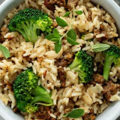 overhead picture of sausage rice and broccoli in white bowl