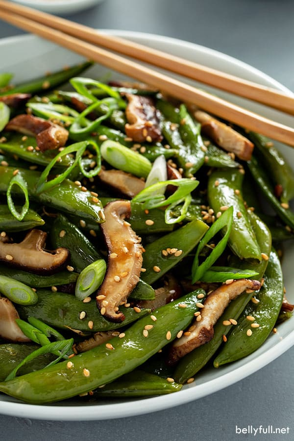 roasted snap peas and shiitake mushrooms in white bowl