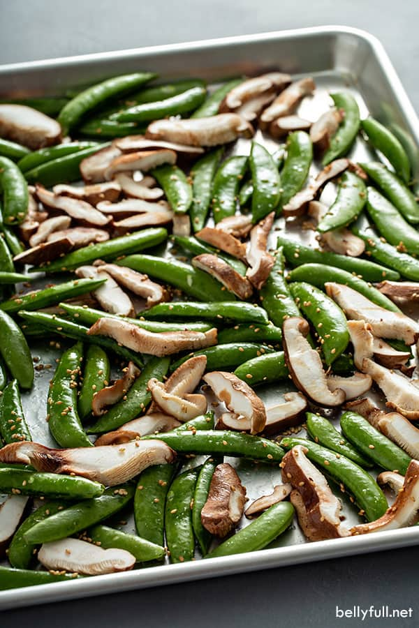 snap peas and shiitake mushrooms on roasting pan