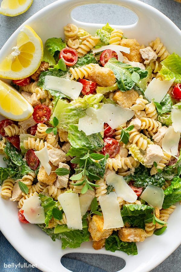 overhead photo of chicken pasta salad in white serving dish