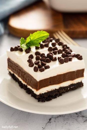 square slice of Oreo lush dessert on white plate