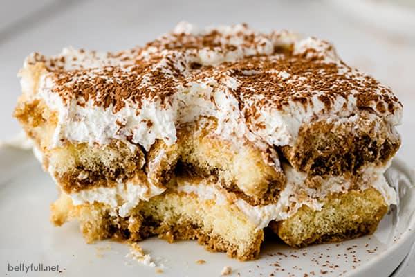 horizontal picture slice of Tiramisu dessert with chunk missing
