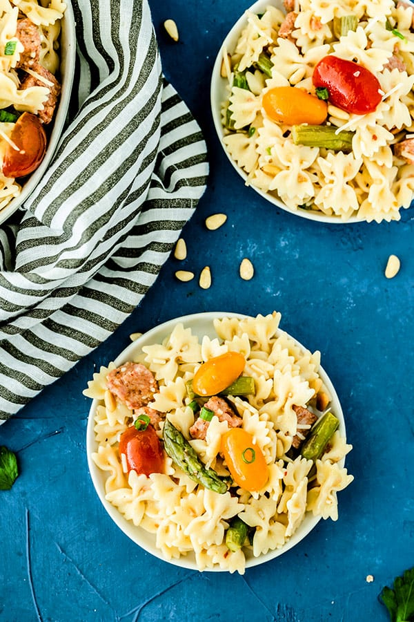 overhead picture of Italian Pasta Salad in white dish on blue background